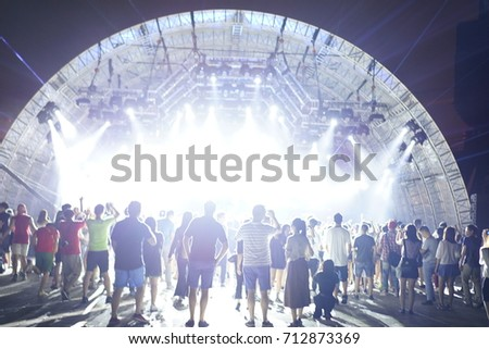 Defocused entertainment concert lighting on stage, blurred disco party and Concert Live. #712873369