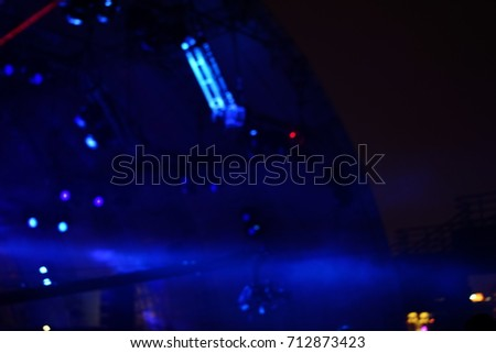 Defocused entertainment concert lighting on stage, blurred disco party and Concert Live. #712873423