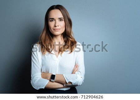 Confident beautiful businesswoman being ready to work Royalty-Free Stock Photo #712904626