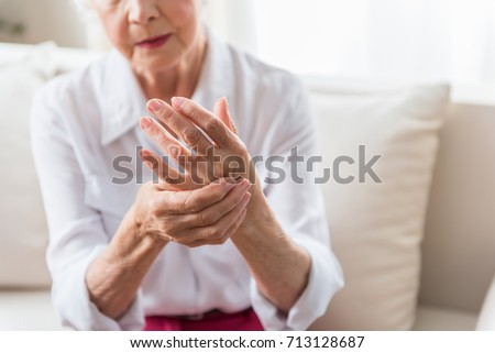 Elderly female is expressing pain #713128687