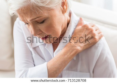 Senior lady is demonstrating suffering from ache #713128708