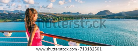 Cruise ship tourist woman Caribbean travel vacation banner. Panoramic crop of girl enjoying sunset view from boat deck leaving port of Basseterre, St. Lucia, tropical island. Royalty-Free Stock Photo #713182501