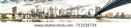 New York City - Stunning panoramic view of Brooklyn and Manhattan Bridge with skyline. #713228734