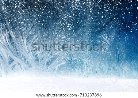 Design of fairy tale forest with snowfall on window frost Royalty-Free Stock Photo #713237896