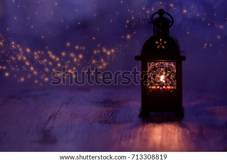 Lantern with candle on a beautiful blue background with stars. Christmas background #713308819