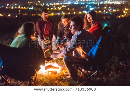 The smile people hold hands near the bonfire. night time  #713336908