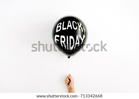 Black Friday concept. Quote Black Friday on black balloon in girl's hand. Flat lay, top view. Black Friday background. #713342668