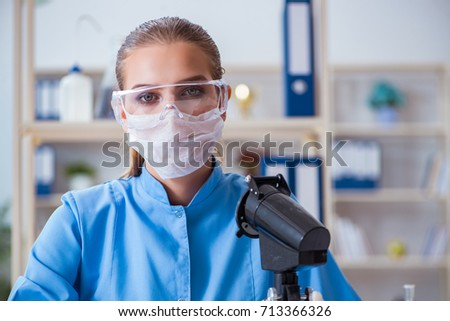 Female scientist researcher conducting an experiment in a labora #713366326