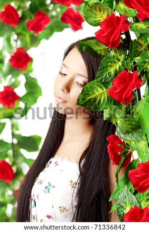 The image of a beautiful girl with bright make-up among the roses #71336842