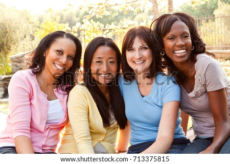 Diverse group of women talking and laughing. #713375815