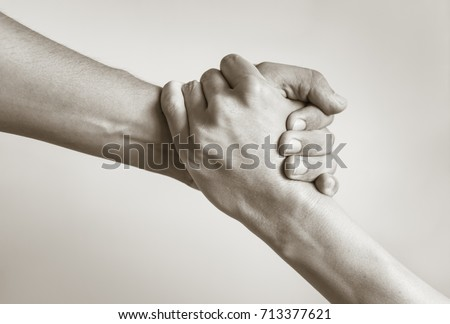 Giving a helping hand.  Royalty-Free Stock Photo #713377621