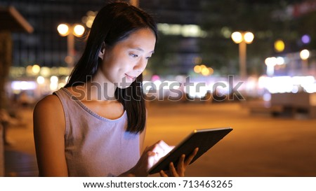 Woman using tablet computer #713463265