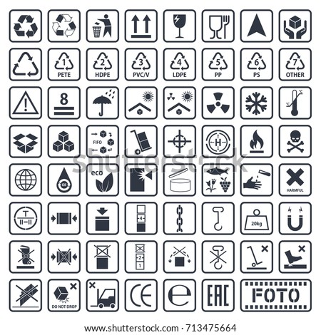 cargo symbols set, packaging icons, package signs set on cardboard Royalty-Free Stock Photo #713475664