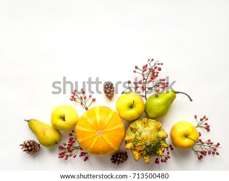Stylish composition of colorful pumpkins, fruits, berries, cones. Top view on white background. Autumn flat lay. Border with a copy space for text Royalty-Free Stock Photo #713500480