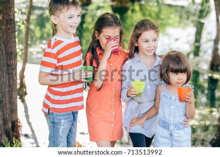 Little lovely boys drinking milk on picnic #713513992
