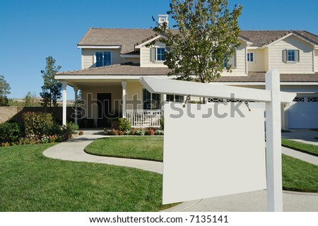 Blank Real Estate Sign in Front of Beautiful New Home