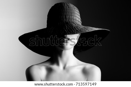 Fashion woman in hat. Contrast black and white.