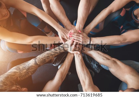 Group of Friends with Stack of Hands #713619685