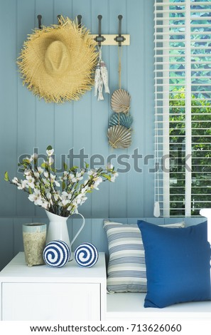 blue cushion and flower vase in coastal home Royalty-Free Stock Photo #713626060