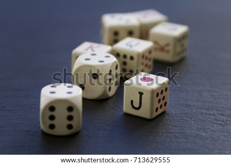 Dice game pieces over back background #713629555