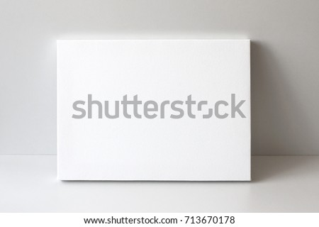 Blank canvas. Gray wall on background. Mock up poster frame, canvas template. #713670178