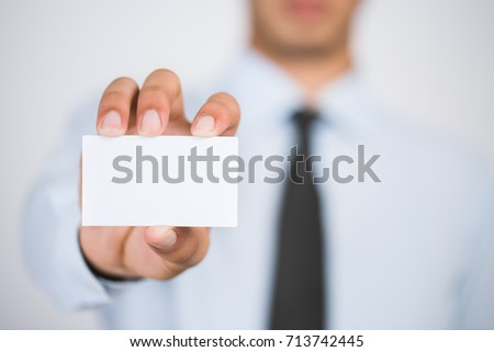 Man's hand showing business card - closeup shot on white background #713742445