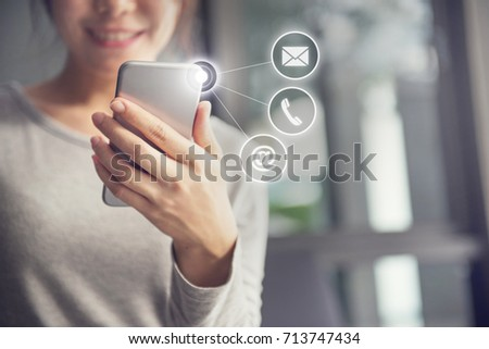 CONTACT US, Hand of Woman holding mobile smartphone with ( mail,phone,email ) icon. cutomer support concept #713747434