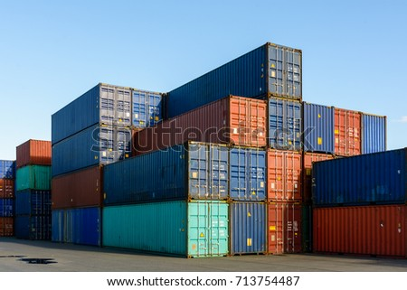 Dozens of metal containers stacked in a shipping yard on the river Marne for the supply of supermarkets in Paris. #713754487