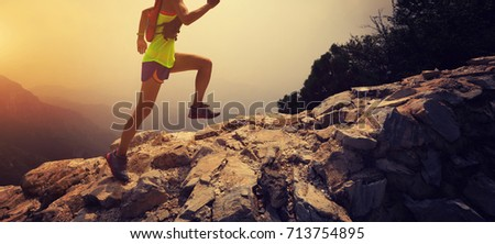 woman trail runner running on the great wall top of mountain #713754895