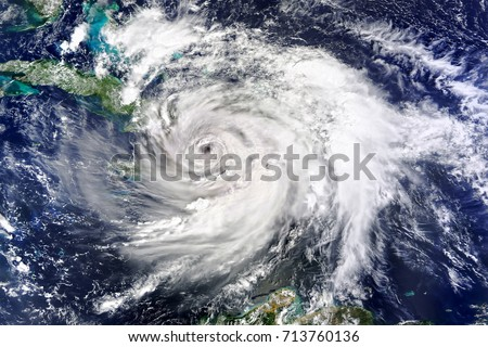 Satellite view. Hurricane Matthew Hits Haiti. Elements of this image furnished by NASA. Royalty-Free Stock Photo #713760136