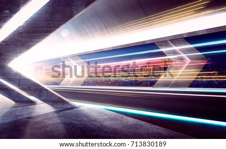 Empty asphalt road tunnel during the night with light trails and beautiful city skyline background . #713830189