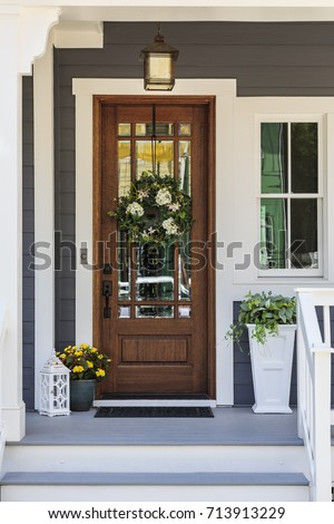 Front door with a decorative wreath  #713913229