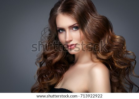 Beautiful woman face with beautiful hair portrait. #713922922