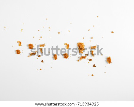 Scattered crumbs isolated on white background #713934925