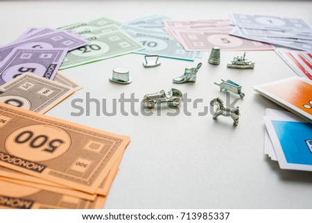 Monopoly board game, playing pieces and cards on white background #713985337