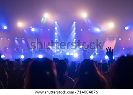 Silhouette hands of audience crowd people  enjoying the club party concert ,Celebrate new year party , Blurry night club party music dancing sound , Party People Blurred Background #714004876