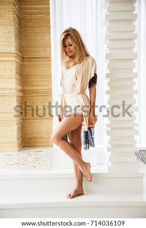 Beautiful girl blonde sexy bottom in lingerie posing in light apartments #714036109