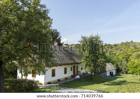 Traditional village houses in Holloko, Hungary. #714039766