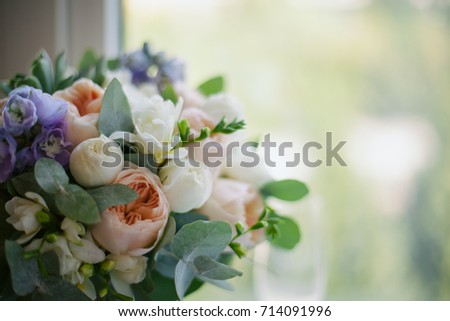 a wedding bouquet lies on the window. vintage toning. Wedding. The bride's bouquet. Wedding bouquet. Green wedding bouquet lying on windowsill #714091996