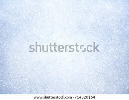 Frozen texture covered by a thin layer of snow - Winter material #714320164