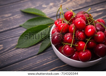 cherry fruit in bowl. wooden background. sweet food #714320344
