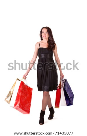 Young happy woman with full of bags after shopping #71435077