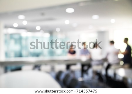 Blurred soft of people meeting at table Royalty-Free Stock Photo #714357475