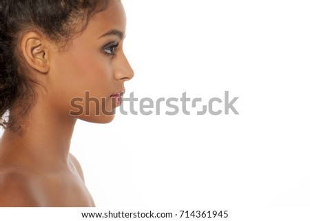 Profile of a beautiful young dark-skinned woman on a white background #714361945