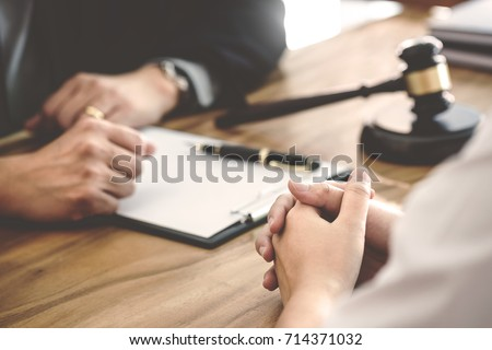 tribunal and justice concept, Consultation with insurance lawyer and customer Royalty-Free Stock Photo #714371032