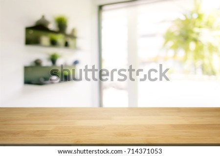 wooden table in front of blurred  background of coffee shop cafe Royalty-Free Stock Photo #714371053