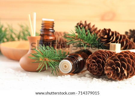 Fresh winter home scent. Medicinal amberglass dropper bottle with green fir-needle and cones, aromalamp diffuser for relaxing healthy spa #714379015