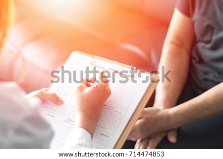 Parkinson and alzheimer female senior elderly patient with professional doctor consult in or counsel diagnosis health in hospital. Medical healthcare concept Royalty-Free Stock Photo #714474853