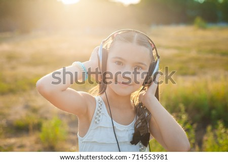 Satisfied girl listening music with headphones #714553981