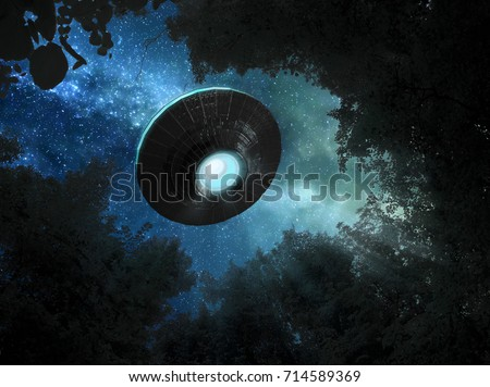 Alien spacecraft is hovering over the trees Royalty-Free Stock Photo #714589369